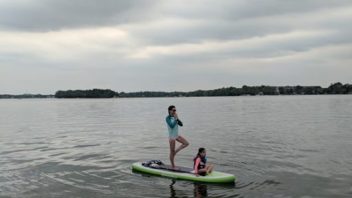 City Beach Watercraft rentals May weekend guide mom and child on paddleboard on lake