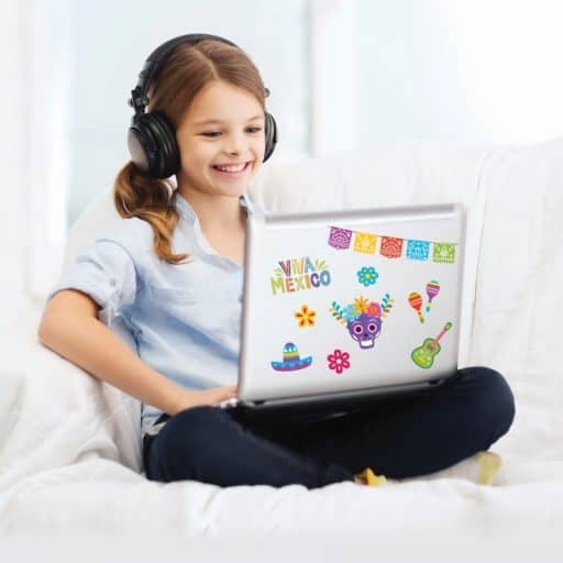 Girl sitting with computer and headphones learning futura language schools enrichment program